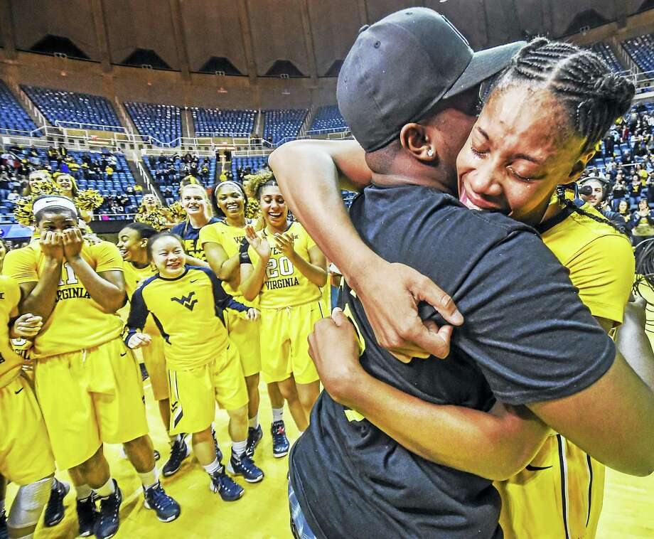 Dale Sparks/West Virginia University Athletic CommunicationsAfter scoring a game-high 27 points to lead her West Virginia women's basketball team to an upset win over Oklahoma State on Senior Day, former Hillhouse standout Bria Holmes capped her memorable day by saying yes to a proposal from longtime boyfriend Oterrious Diggins Saturday. Photo: Journal Register Co.