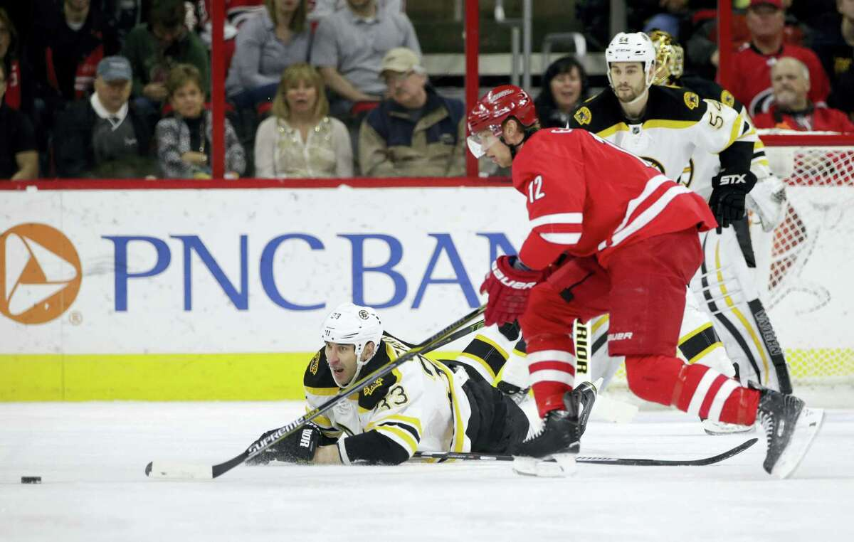 Carolina Hurricanes' Eric Staal (12) is chased by Boston Bruins' Zdeno Chara (33) Friday. Staal was traded to the Rangers on Sunday.