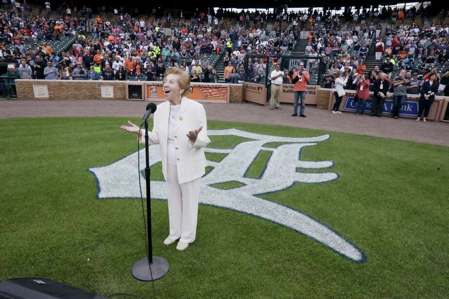 Hermina Hirsch, 89, a Holocaust survivor, sings the national anthem before the baseball game between the Detroit Tigers and the Tampa Bay Rays on Saturday. Photo: Carlos Osorio — The Associated Press   / Copyright 2016 The Associated Press. All rights reserved. This material may not be published, broadcast, rewritten or redistribu