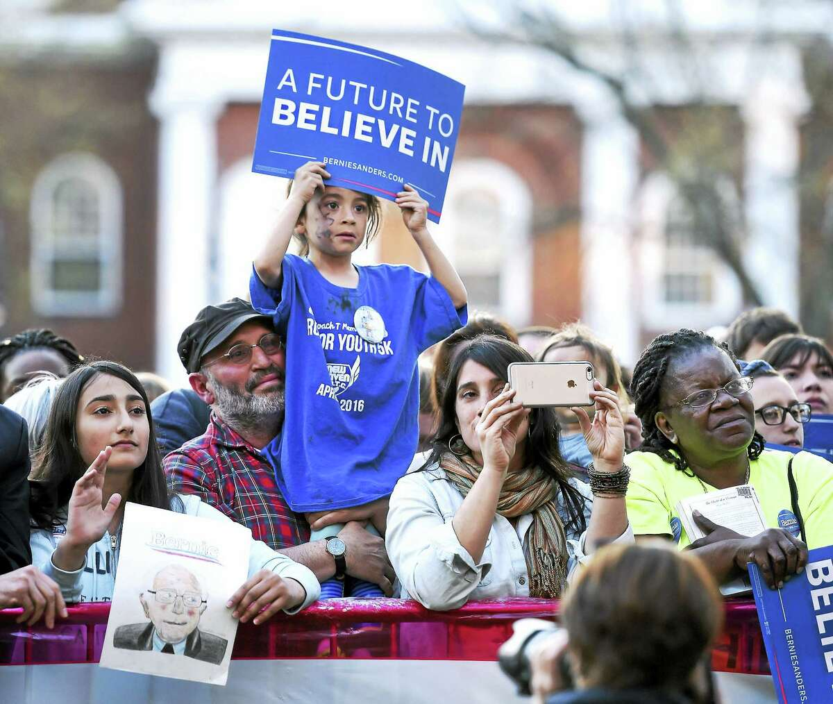 Arnold Gold-New Haven Register Suppporters listen to Democratic presidential candidate Bernie Sanders on the Green.