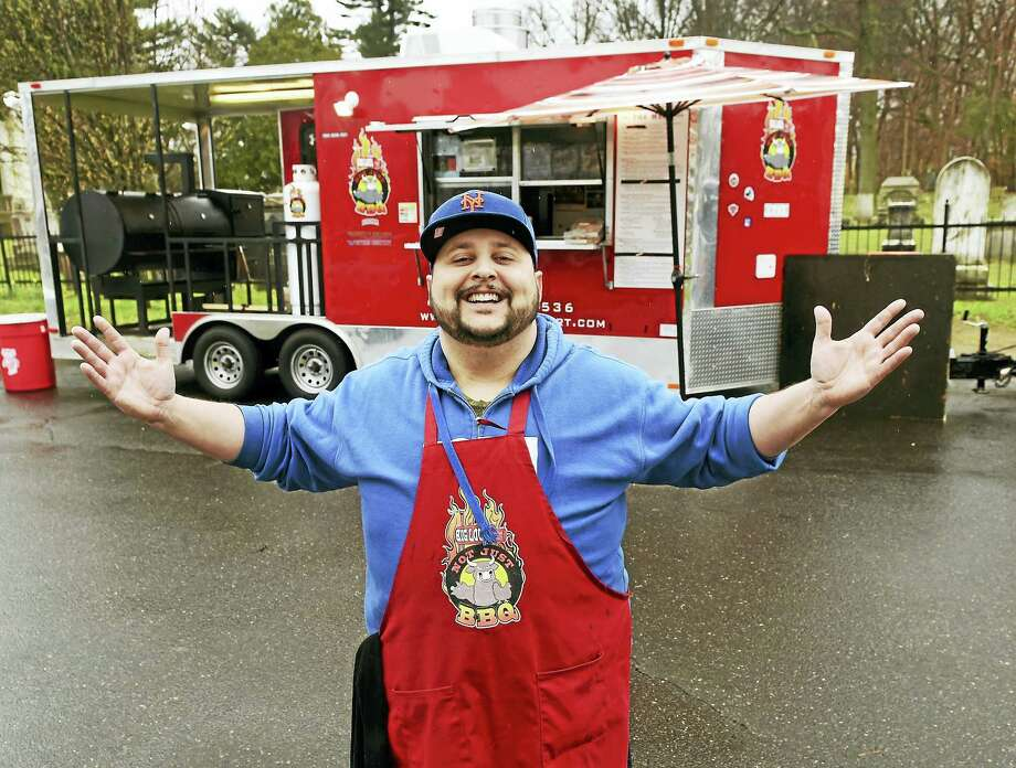 "Louis Forte, who operates a food truck out of East Haven called ""Not Just BBQ"" on River Street next to the East Haven Green Thursday. The food truck is equipped with a smoker. Photo: Peter Hvizdak - New Haven Register   / ?2016 Peter Hvizdak"