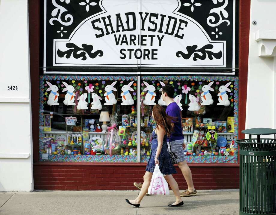 A couple walks past the Shadyside Variety Store in the Shadyside section of Pittsburgh recently. Photo: Gene J. Puskar — The Associated Press   / AP