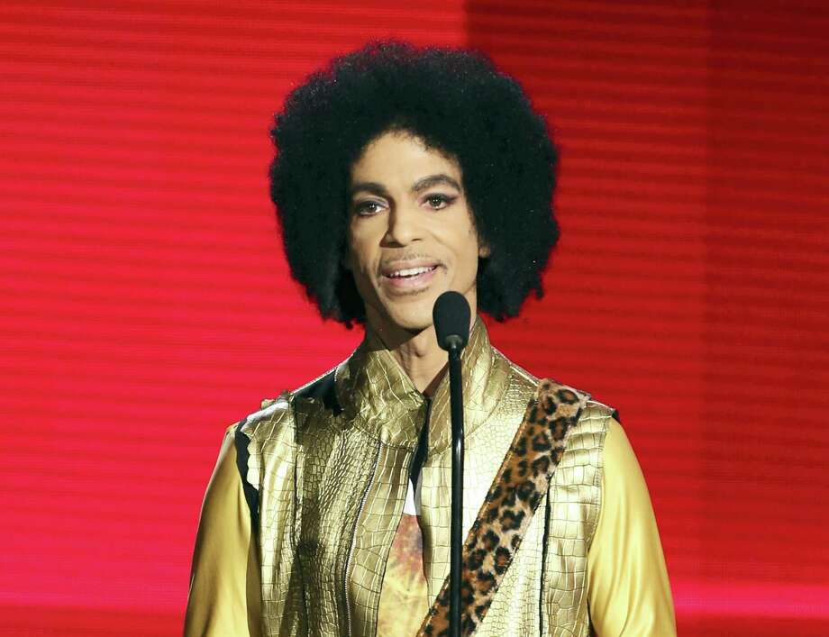 "In this Nov. 22, 2015 photo, Prince presents the award for favorite album — soul/R&B at the American Music Awards in Los Angeles. Prince, widely acclaimed as one of the most inventive and influential musicians of his era with hits including ""Little Red Corvette,"" ''Let's Go Crazy"" and ""When Doves Cry,"" was found dead at his home on Thursday, April 21, 2016 in suburban Minneapolis, according to his publicist. He was 57. Photo: Photo By Matt Sayles/Invision/AP, File   / Invision"