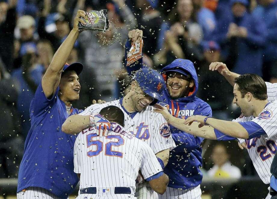David Wright, center, is showered with sunflower seeds after driving in the game-winning run against the Brewers on Saturday. Photo: Julie Jacobson — The Associated Press   / Copyright 2016 The Associated Press. All rights reserved. This material may not be published, broadcast, rewritten or redistribu