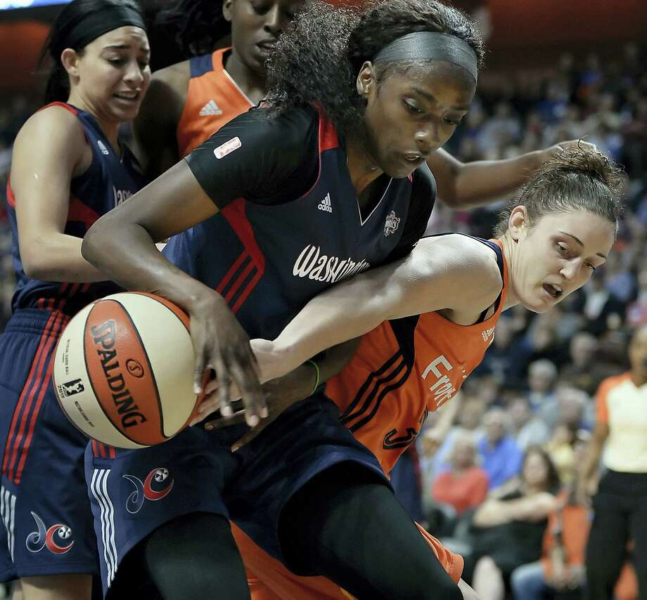 The Sun's Kelly Faris, right, tries to get the ball from the Mystics' Kahleah Copper on Saturday. Photo: Jessica Hill — The Associated Press   / AP2016