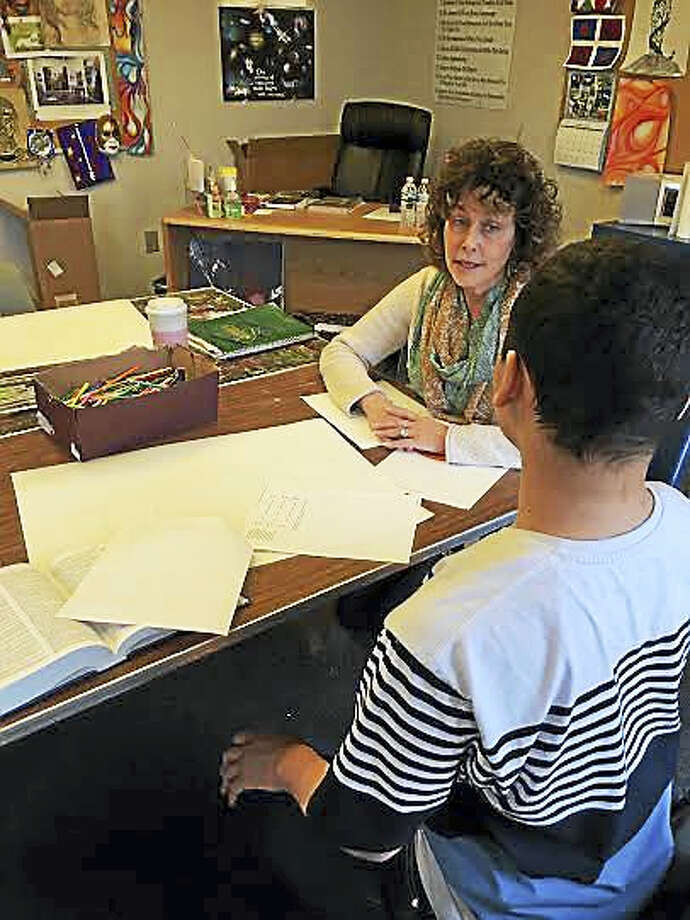 Art therapist Ellie Nicol works with a patient (Contributed photo). Photo: Journal Register Co.