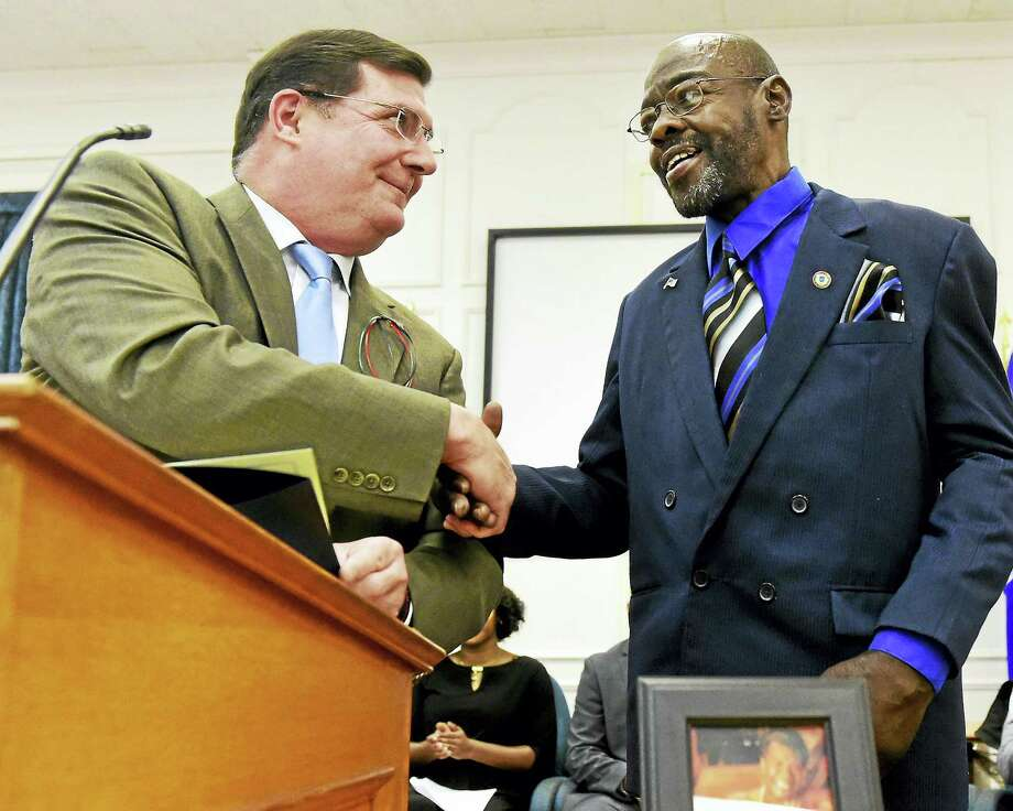 West Haven Mayor Edward M. O'Brien shares a citation honoring City Councilman Brent Watt as the 2016 West Haven African-American Citizen of the Year Monday during the 20th annual West Haven Black Heritage Celebration at City Hall. Photo: Peter Hvizdak — New Haven Register   / ©2016 Peter Hvizdak