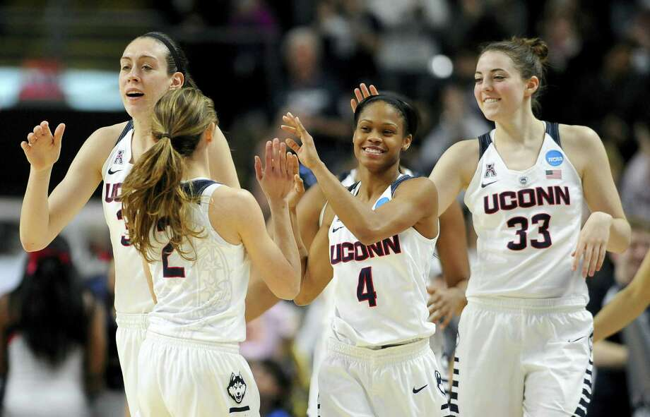UConn's Briana Pulido (2) is greeted by Breanna Stewart, left, Moriah Jefferson, center, and Katie Lou Samuelson at the end of Saturday's NCAA tournament regional semifinal game in Bridgeport. Photo: Jessica Hill — The Associated Press   / AP2016