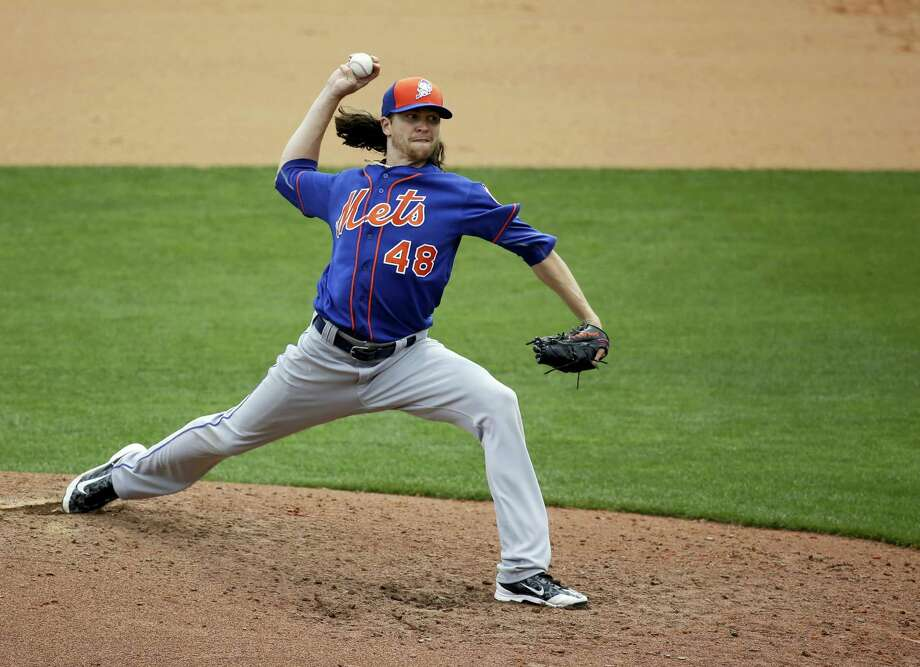 Mets starting pitcher Jacob deGrom throws against the Braves during a spring training game on Saturday. Photo: John Raoux — The Associated Press   / AP