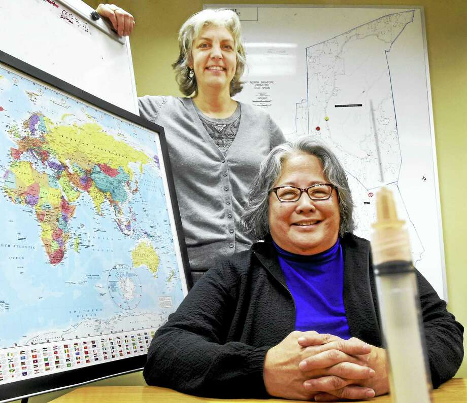 Public health nurse Rita Foster, R.N., left, and Dr. Margaret Ikeda, M.D., both of the East Shore District Health Department in Branford, administer vaccines and prescriptions to people who plan travel in countries that require immunizations. Photo: Peter Hvizdak — New Haven Register   / ©2016 Peter Hvizdak