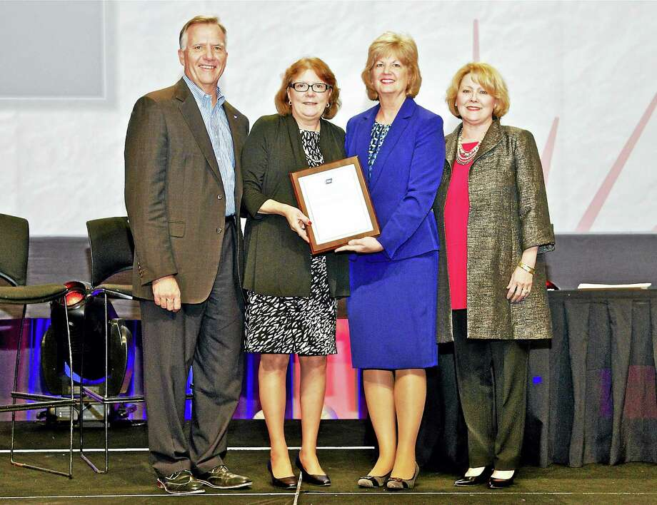 CONTRIBUTED PHOTOFrom left, Gary Reedy, CEO, American Cancer Society; Kimberly Bielecki; Scarlott Mueller, chair, American Cancer Society Board of Directors; and Susan Henry, chair, Lane Adams Quality of Life Award Workgroup. Photo: Journal Register Co.