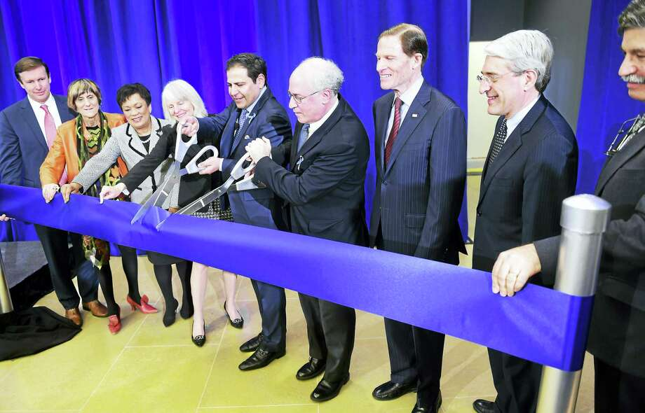 Alexion Pharmaceuticals CEO David Hallal, center left, and Leonard Bell, center right, chairman of the board of Alexion, cut a ribbon during Monday's dedication ceremony. From left are U.S. Sen.  Chris Murphy, U.S. Rep. Rosa DeLauro, New Haven Mayor Toni Harp, Commissioner of the Connecticut Department of Economic and Community Development Catherine Smith, Hallal, Bell, U.S. Sen.Richard Blumenthal, Yale President Peter Salovey and Community Foundation of Greater New Haven President and CEO Will Ginsberg. Photo: Arnold Gold — New Haven Register