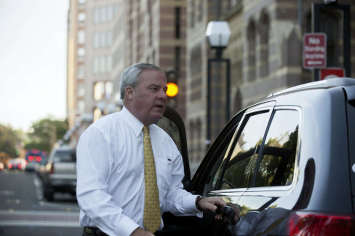 Former Gov. John G. Rowland leaving U.S. District Court in 2014.