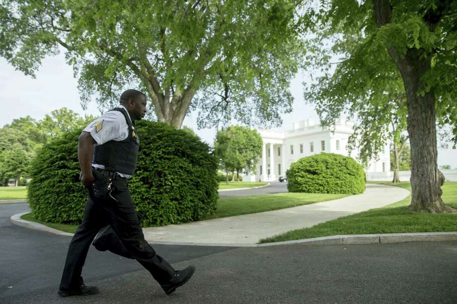 A uniformed Secret Service agent walks on North Lawn of the White House in Washington Friday, May 20, 2016, after a security alert was lifted. A uniformed Secret Service officer shot a person who drew a weapon just outside the White House Friday afternoon, a U.S. law enforcement official said. Photo: AP Photo — Andrew Harnik / Copyright 2016 The Associated Press. All rights reserved. This material may not be published, broadcast, rewritten or redistribu