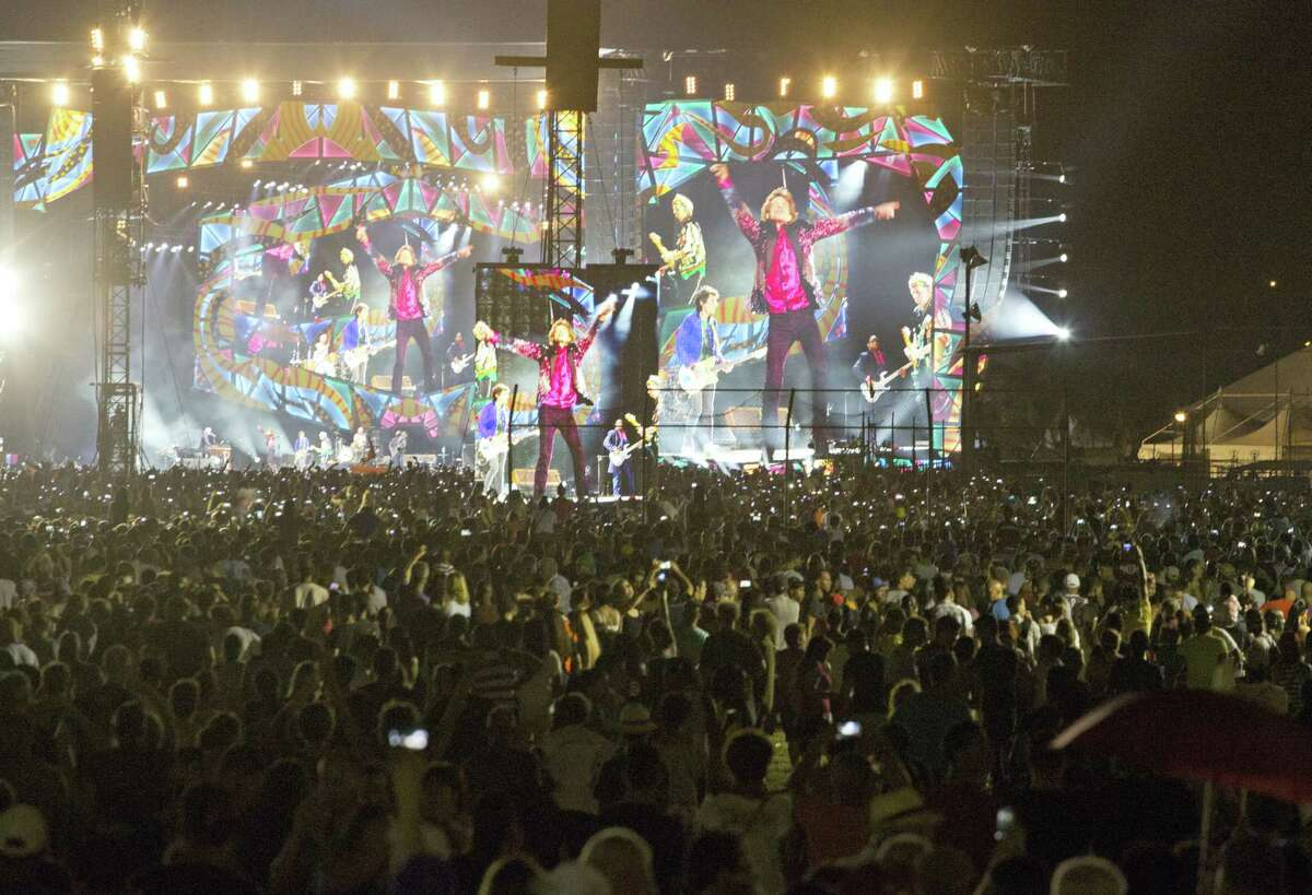 The Rolling Stones are seen on giant screens as they perform for thousands at the Cuidad Deportiva in Havana, Cuba, Friday March 25, 2016. The Stones performed a free concert in Havana, becoming the most famous act to play Cuba since its 1959 revolution.