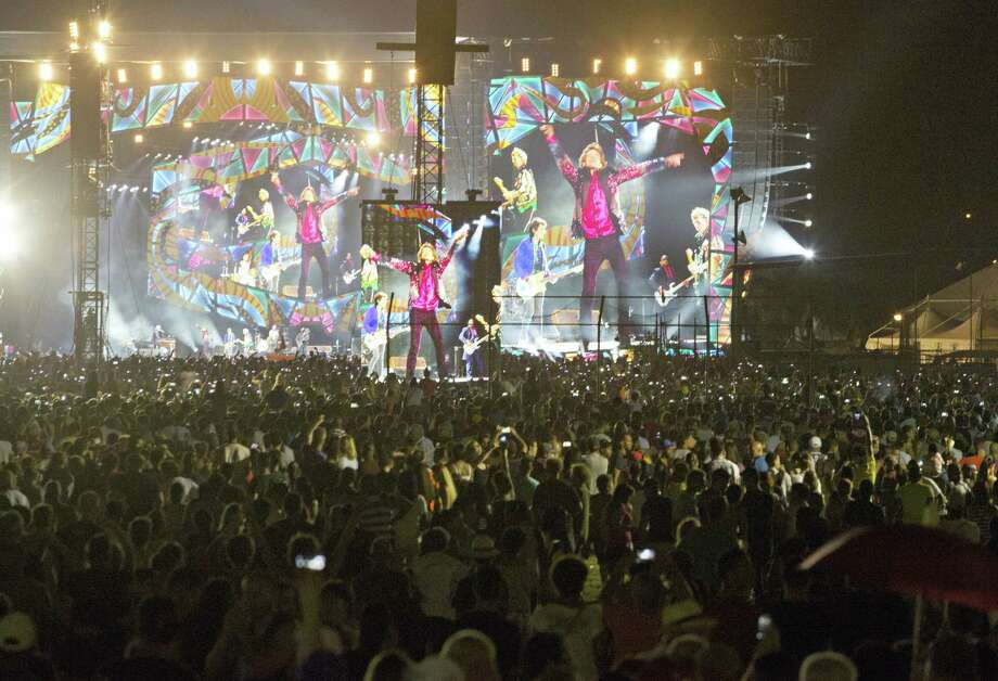 The Rolling Stones are seen on giant screens as they perform for thousands at the Cuidad Deportiva in Havana, Cuba, Friday March 25, 2016. The Stones performed a free concert in Havana, becoming the most famous act to play Cuba since its 1959 revolution. Photo: AP Photo — Desmond Boylan / AP