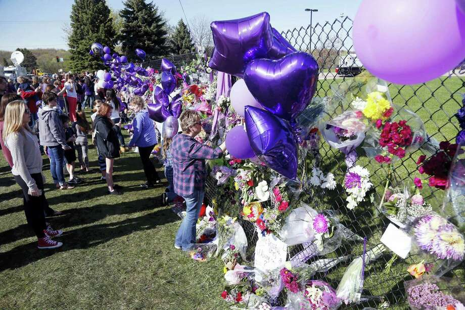 A memorial fence in memory of pop star Prince is lined with flowers and signs at Paisley Park Studios Friday, April 22, 2016 in Chanhassen, Minn. Prince died Thursday at Paisley Park at the age of 57. Photo: AP Photo — Jim Mone / Copyright 2016 The Associated Press. All rights reserved. This material may not be published, broadcast, rewritten or redistributed without permission.