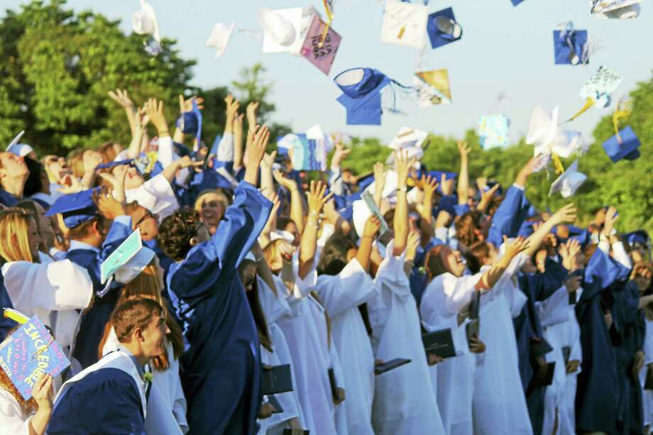 The sky over the sports field at Old Saybrook High School was filled Thursday with the blue and white mortarboards of 127 triumphant graduates. Photo: Valerie Bannister Photo