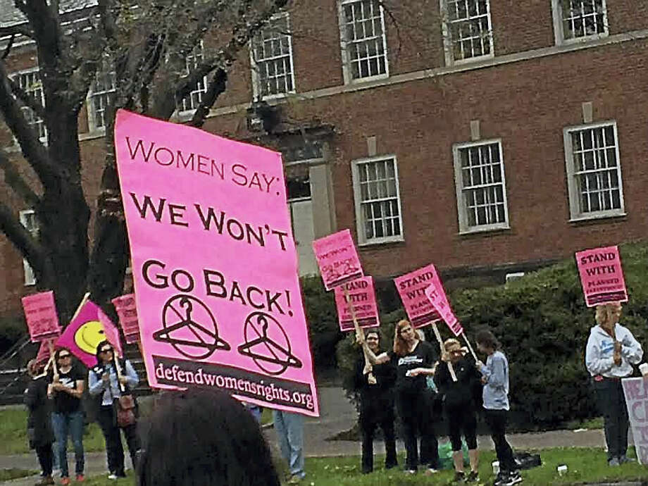 Members of the reproductive rights group, Women Organized to Resist and Defend, hold a rally in support of the New Haven office of Planned Parenthood. The group was seeking to counteract a protest by anti-abortion activists. Photo: Luther Turmelle — New Haven Register