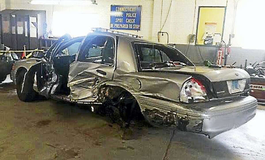 A state trooper was taken to the hospital with minor injuries early Saturday after a car crashed into his cruiser on Interstate 91 in North Haven. The driver of that car, a North Haven man, was charged with operating under the influence of drugs or alcohol. Photo: Photo From The North Haven Fire Department