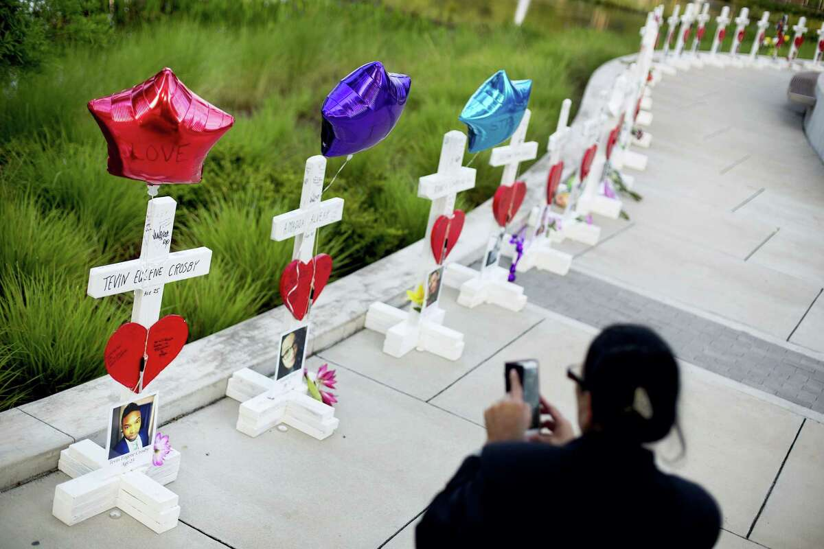 Crosses, one for each victim, line a walkway Friday a few blocks from the Pulse nightclub as a memorial to those killed in the mass shooting at the club.