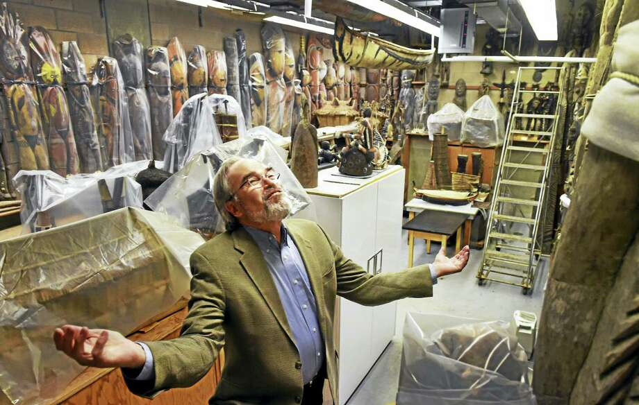"Author Richard Conniff of Old Lyme, who authored the book ""House of Lost Worlds"" about the history of the Yale Peabody Museum of Natural History and the people that made it a great museum shares his excitement about the many stories it holds while standing in the inner sanctum of Anthropological Collection Storage Room in the museum's basement, Wednesday morning, March 23, 2016. The book celebrates the museum's 150th anniversary. A 150th Anniversary celebration exhibit will open April 2, 2016. Photo: Peter Hvizdak — New Haven Register   / ©2016 Peter Hvizdak"