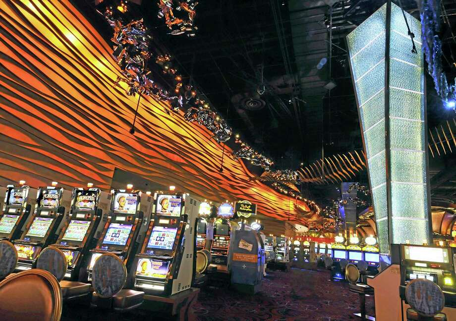 Slot machines on the floor of the Casino of the Wind at Mohegan Sun in Uncasville. Photo: AP Photo — Jessica Hill, File / FR125654 AP