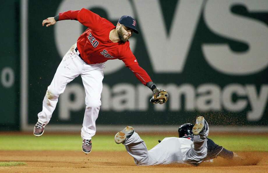 The Indians' Lonnie Chisenhall steals second base as Dustin Pedroia comes up short on the tag during the eighth inning Friday. Photo: Michael Dwyer — The Associated Press   / AP