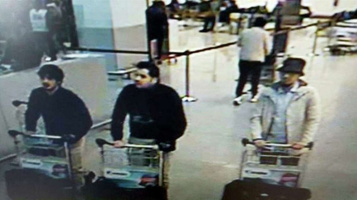 In this image provided by the Belgian Federal Police in Brussels on Tuesday, March 22, 2016, three men who are suspected of taking part in the attacks at Belgium's Zaventem Airport and are being sought by police. The men on both the left and right are yet unidentified, the man at center has been the identified by the Federal Prosecutors office on Wednesday, March 23, 2016 as Ibrahim El Bakraoui.
