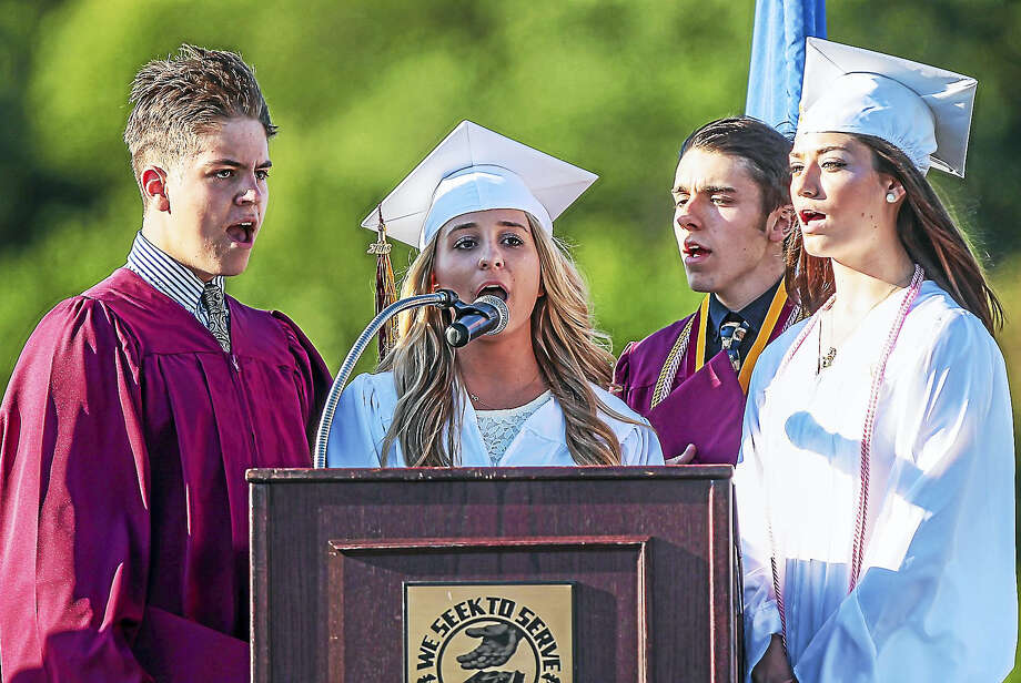 Sheehan High School graduates Stephen Chubert, Alicia Eldridge, Rebecca Gersz and Eric Thompson sing the national anthem to begin graduation exercises for the class of 2016 of Mark T. Sheehan High School Friday in Wallingford. Photo: John Vanacore — For The Register   / John Vanacore/Register