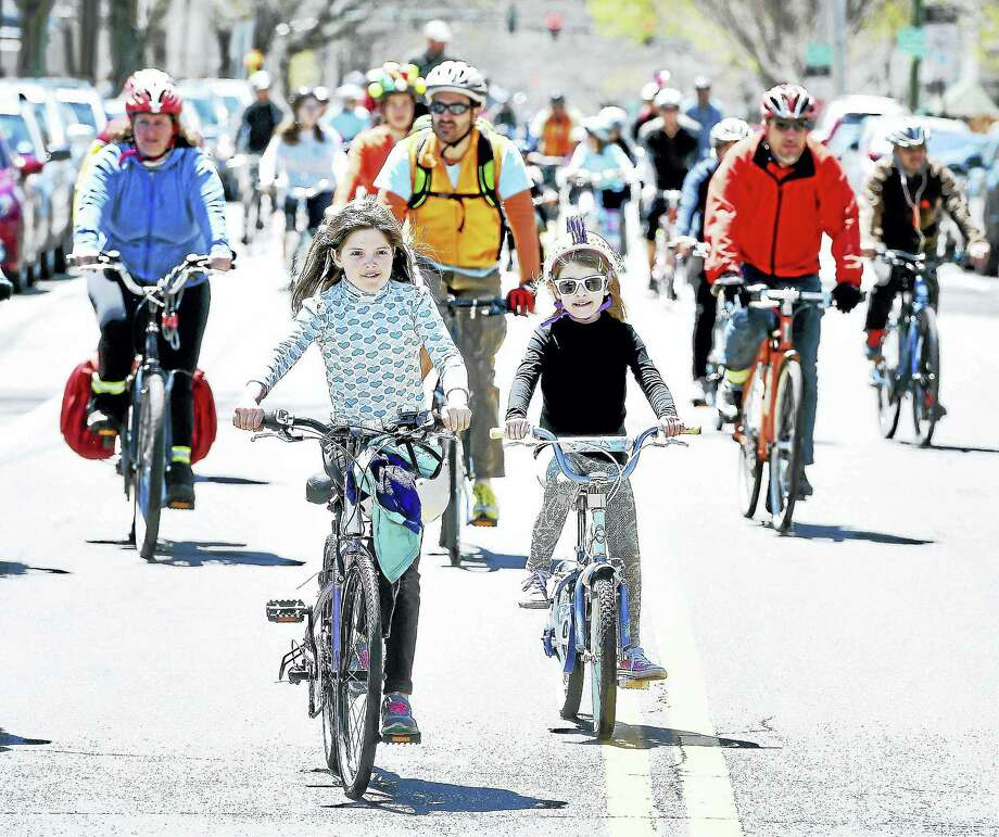 Riders finish the 8-mile ride in the 7th Annual Rock to Rock Earth Day Ride at East Rock Park in New Haven in April 2015. More than 1,200 riders participated, raising more than $175,000. Photo: Arnold Gold — New Haven Register