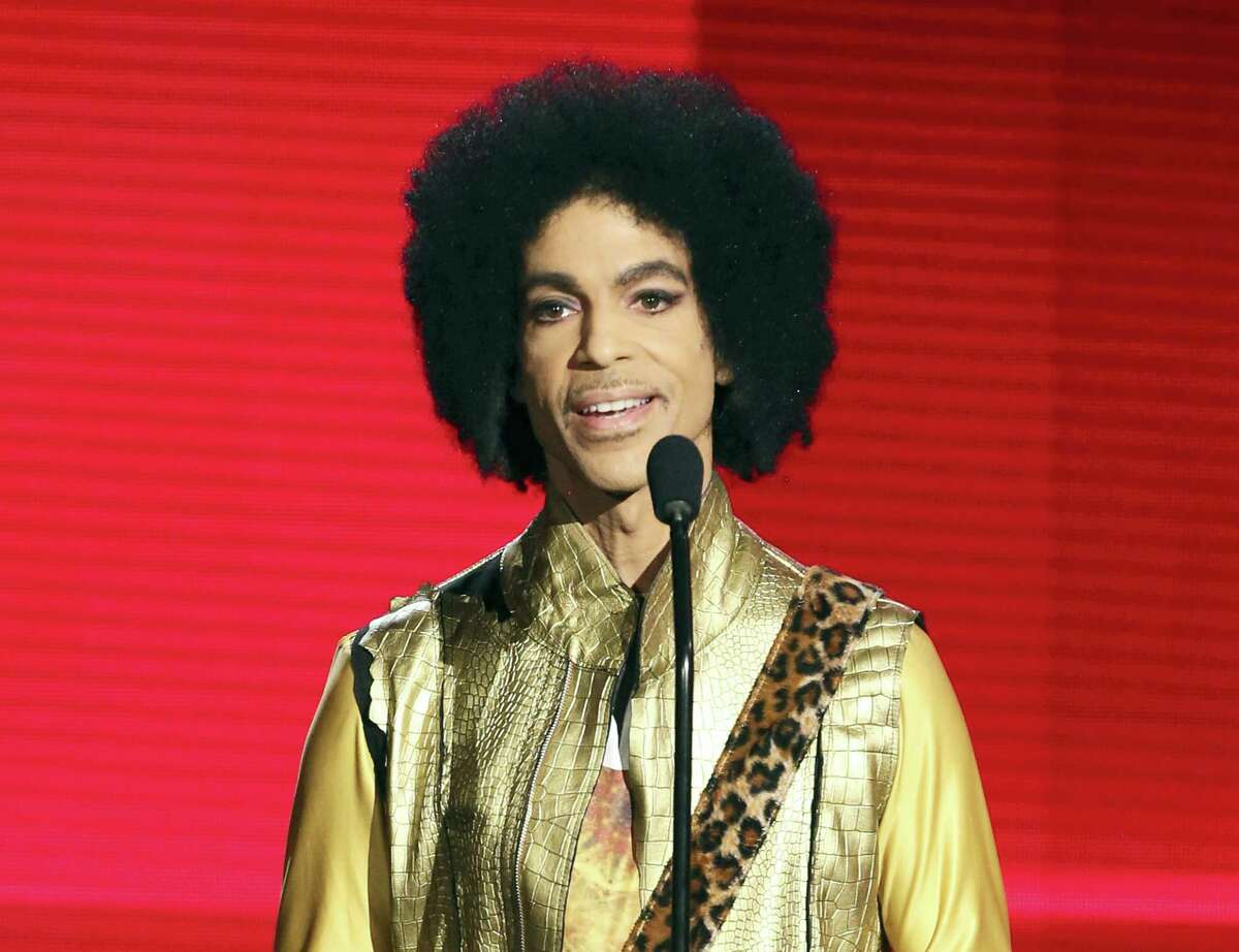 In this Nov. 22, 2015 file photo, Prince presents the award for favorite album - soul/R&B at the American Music Awards in Los Angeles.