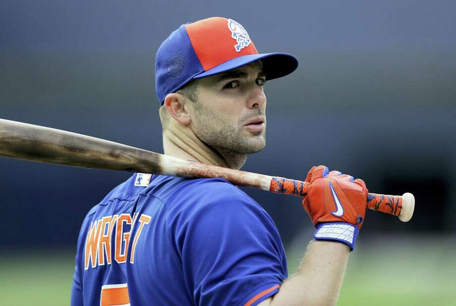 The Mets' David Wright will have surgery to repair a herniated disk in his neck. Photo: The Associated Press File Photo   / AP