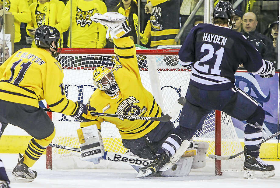 Quinnipiac goaltender Michael Garteig makes a save in the second period of Saturday's win over Yale. Photo: John Vanacore — For The Register   / (c)John H.Vanacore/Register