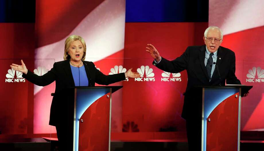 Democratic presidential candidates, former Secretary of State Hillary Clinton, left, and Sen. Bernie Sanders, I-Vt., talk over each other during the Democratic presidential primary debate at the Gaillard Center, Sunday, Jan. 17, 2016, in Charleston, S.C. Photo: AP Photo/Mic Smith    / AP