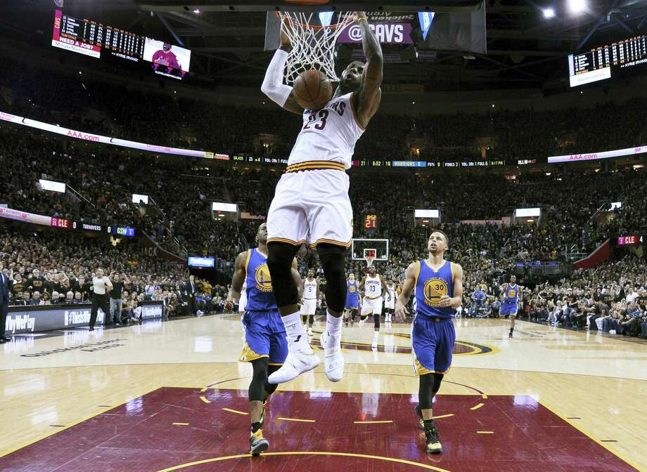 LeBron James dunks during the first half of Game 6 of the NBA Finals in Cleveland on Thursday. Photo: The Associated Press   / Pool EPA