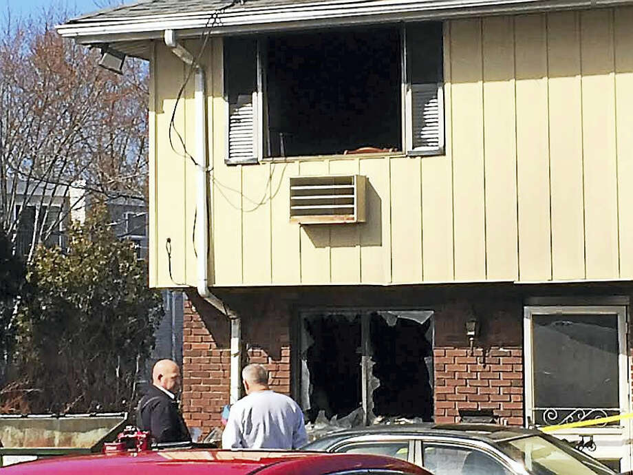 466 Main Street, East Haven, where a morning fire forced a woman out of the townhouse and sent her to the hospital. Photo: LUTHER TURMELLE — NEW HAVEN REGISTER