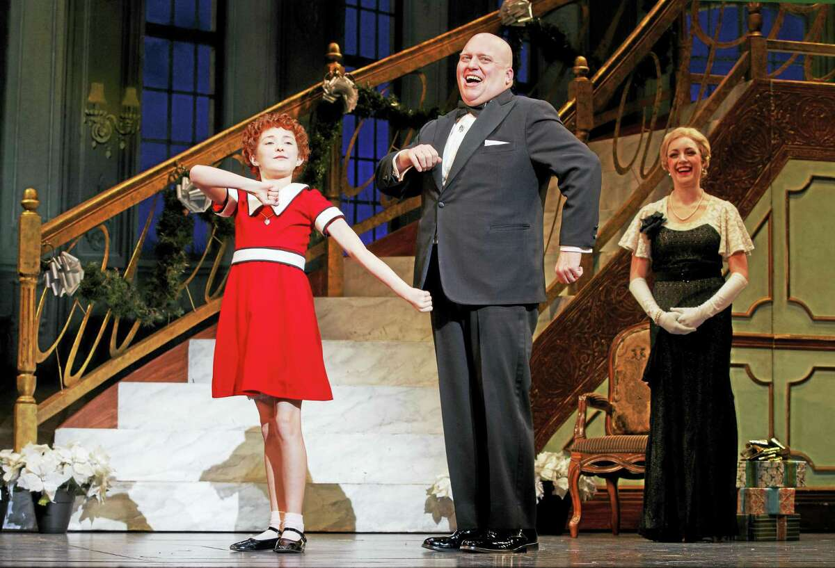 """From left, Heidi Gray as Annie, Gilgamesh Taggett as Oliver Warbucks and Chloe Tiso as Grace Farrell sing """"I Don't Need Anything But You."""""""