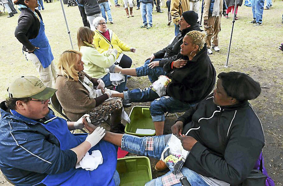 Trinity Episcopal Church on the Green in New Haven holds its 7th annual foot-care clinic and foot-washing on the upper New Haven Green Thursday afternoon. Photo: (Peter Hvizdak - New Haven Register)