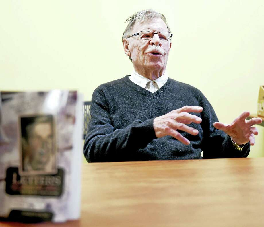 Author Charles Young speaks about his World War II experience at the Hagaman Memorial Library in East Haven Wednesday. Photo: PETER HVIZDAK — NEW HAVEN REGISTER   / ?2016 Peter Hvizdak