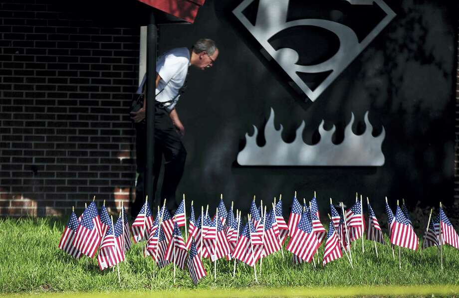 American flags, one for each victim of Sunday's mass shooting, stand outside a firehouse next to the Pulse nightclub on June 16, 2016 in Orlando, Fla. Photo: AP Photo — David Goldman   / Copyright 2016 The Associated Press. All rights reserved. This material may not be published, broadcast, rewritten or redistribu