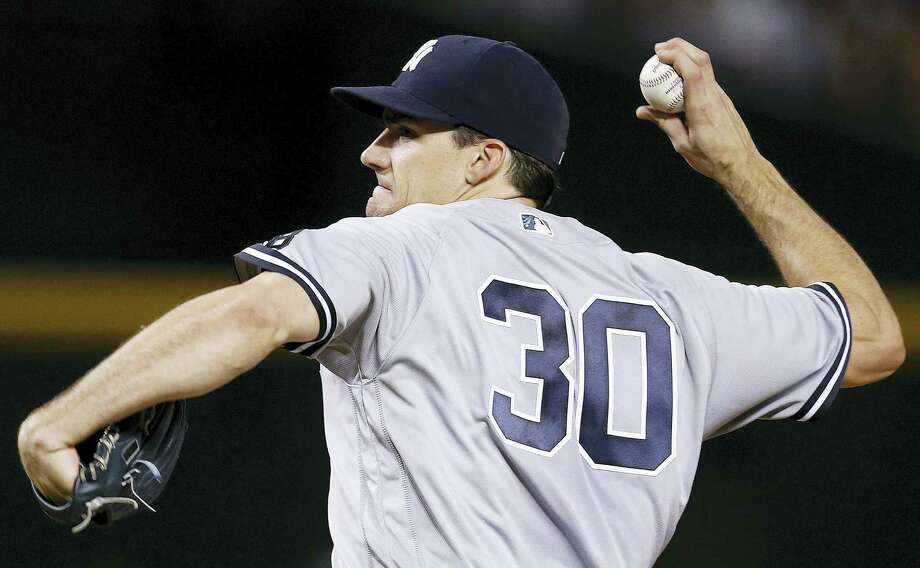 New York Yankees' Nathan Eovaldi throws a pitch against the Arizona Diamondbacks during the fourth inning of a baseball game Wednesday in Phoenix. Photo: The Associated Press   / Copyright 2016 The Associated Press. All rights reserved. This material may not be published, broadcast, rewritten or redistribu