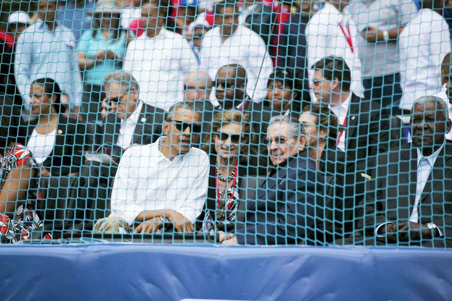 President Barack Obama and Cuban President Raul Castro take their seats before a baseball game between the Tampa Bay Rays and the Cuban national team in Havana, Cuba, Tuesday. Photo: Will Vragovic — The Tampa Bay Times Via AP   / The Tampa Bay Times