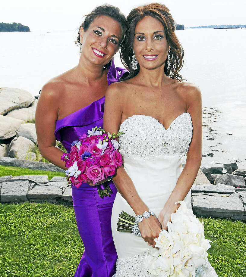 Sisters, from left are bridesmaid identical twin Lindsay Marottoli Greenberg and bride the late Melissa Marottoli Hogan. Photo: Contributed Photo