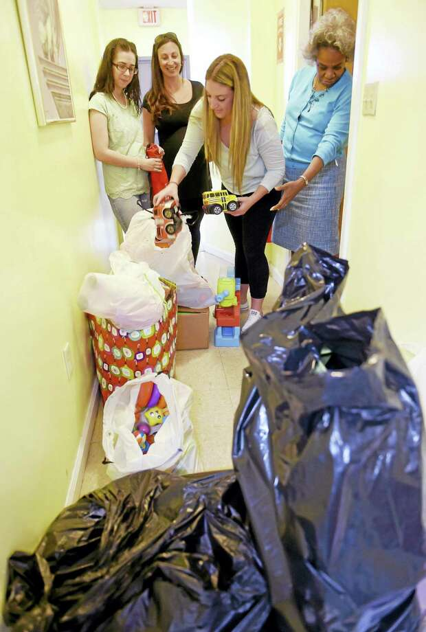 Mikayla Aballone, 16, an East Haven High School junior, third from left, with the more than 100 toys she collected from three East Haven elementary schools and delivered to Christian Community Action in New Haven as a Capstone community service project required for graduation. With Aballone is Nicole Smith of Christian Community Action, left, Julie Goraieb, East Haven High School library media specialist and Capstone instructor, second from left, and the Rev. Bonita Grubbs, executive director of Christian Community Action. Photo: Peter Hvizdak — New Haven Register   / ©2016 Peter Hvizdak