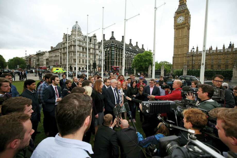 Labour Party leader Jeremy Corbyn, center, speaks to the media, Thursday June 16, 2016, during an impromptu vigil at Parliament Square opposite the Palace of Westminster, central London, following the death of Labour Member of Parliament, Jo Cox. The British lawmaker who campaigned for the country to stay in the European Union was killed Thursday by a gun- and knife-wielding attacker in her small-town constituency, a tragedy that brought the country's fierce, divisive referendum campaign to a shocked standstill. Photo: Philip Toscano — PA Via AP   / PA