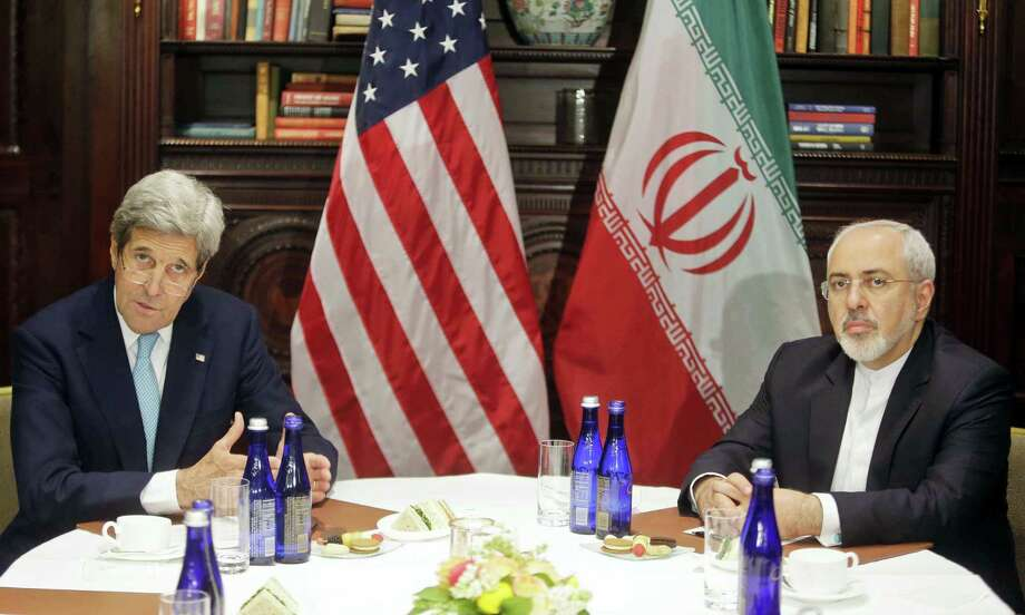 U.S. Secretary of State John Kerry, left, speaks to the media as he meets with Iranian Foreign Minister Mohammad Javad Zarif, right, Friday, April 22, 2016, in New York. Photo: AP Photo — Frank Franklin II / Copyright 2016 The Associated Press. All rights reserved. This material may not be published, broadcast, rewritten or redistributed without permission.