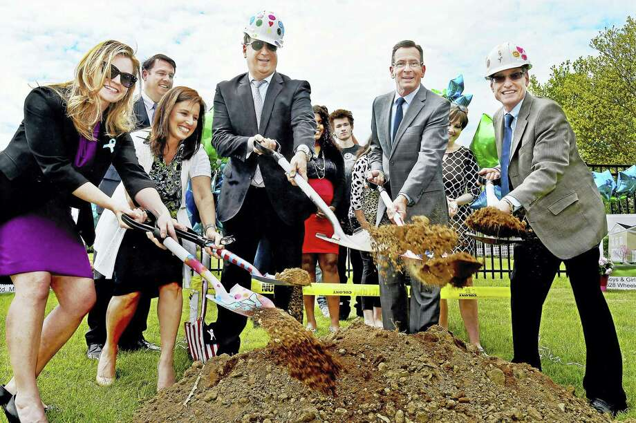 Elizabeth Duryea, Chief of Staff for the Department of Children and Families, State Senator Gayle Slossberg, Joe Tramuta, vice chair for the Board of Directors, Governor Dannel Malloy and Dr. Steven M. Kant, president and chief executive officer, left to right, participate in a ceremonial ground breaking Wednesday at the main campus of Boys & Girls Village at 528 Wheelers Farms Road in Milford. Photo: (Catherine Avalone/New Haven Register) / New Haven RegisterThe Middletown Press