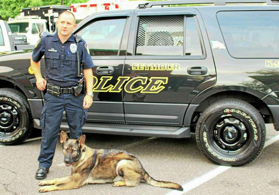 Seymour police Officer John Oczkowski and Sage. Photo: Jean Falbo-Sosnovich — New Haven Register