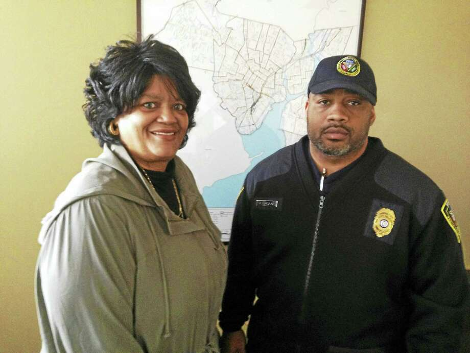 Dispatcher Angela Watley and PSAP Director Michael Briscoe one day after a potentially suicidal man called 911. Photo: Ryan Flynn — New Haven Register